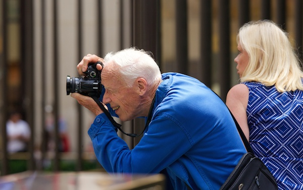 Bill Cunningham, fashion photographer for The New York Times, working in Midtown